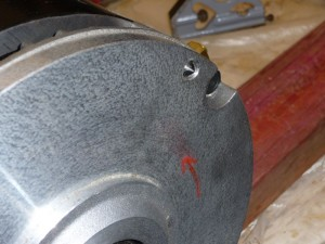 Using a punch to mark bolt holes